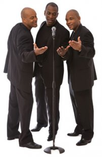 a trio of male voices singing
